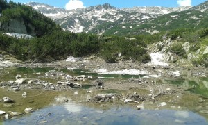 Mud floating on ice in Okoto lake, Pirin.